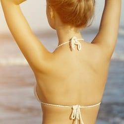 Beautiful woman enjoying sun on the beach