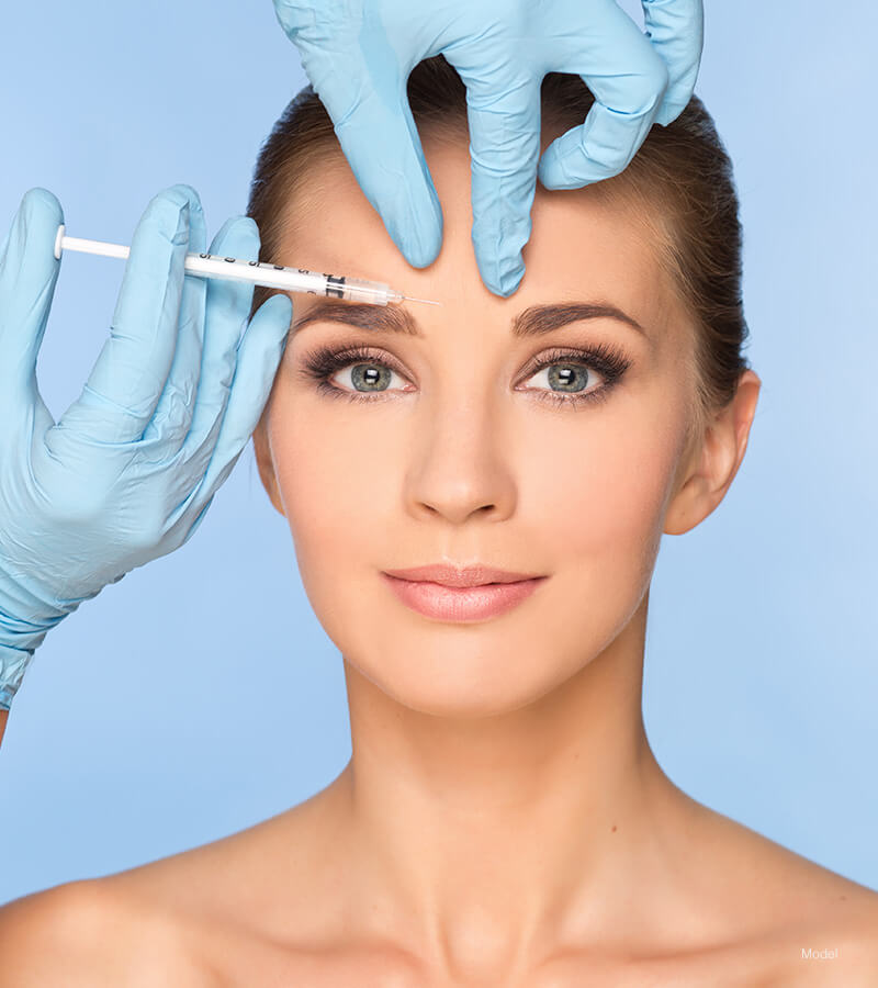 Woman getting injection between brows