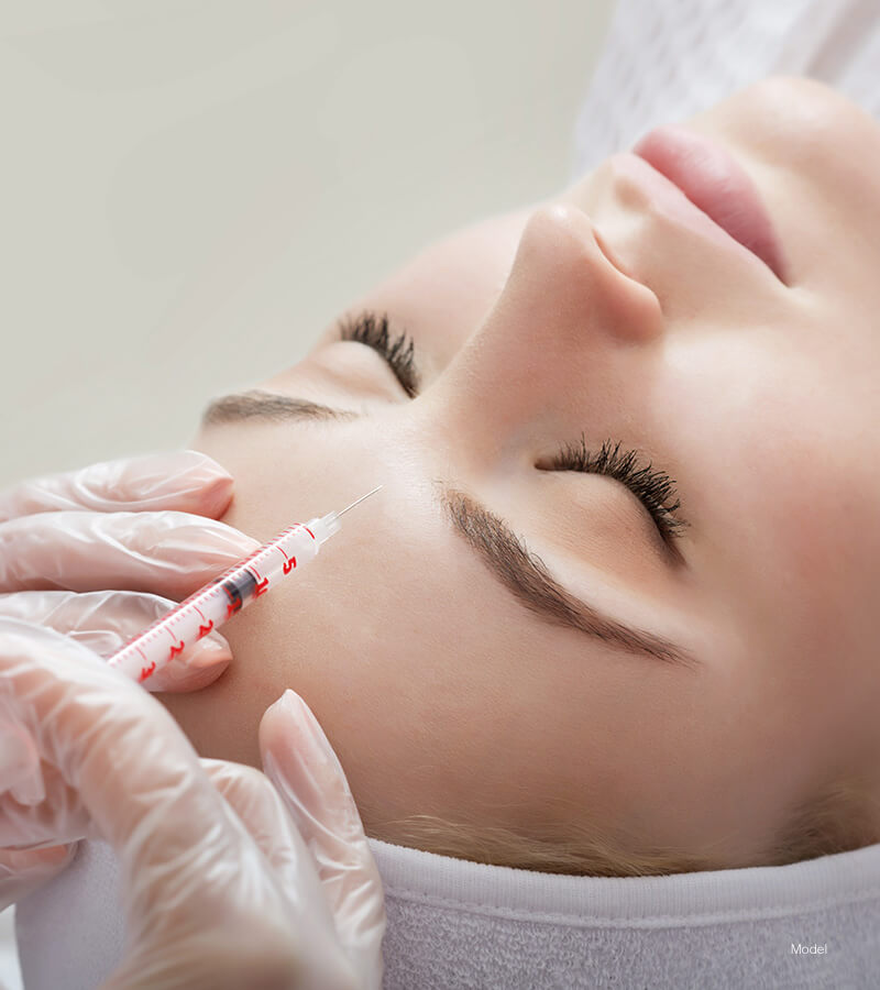 Woman laying getting brow injection