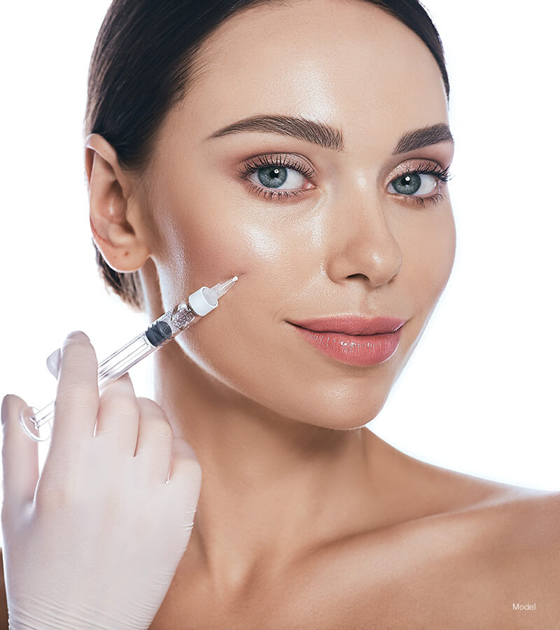 Blue eyed woman getting face injection