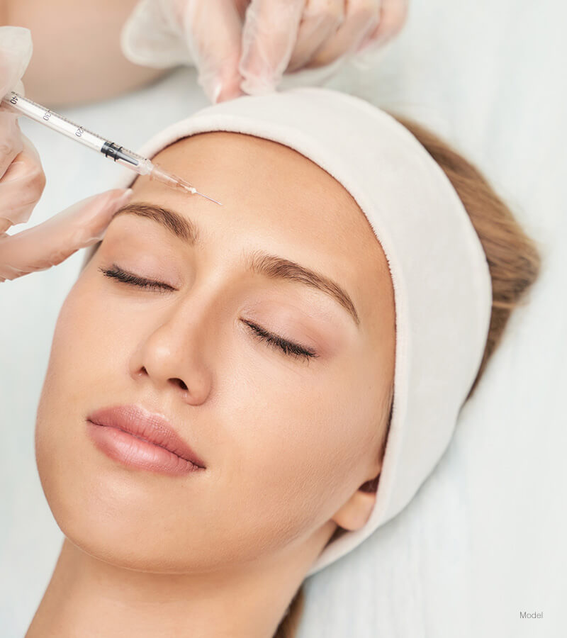 woman getting Forehead injection
