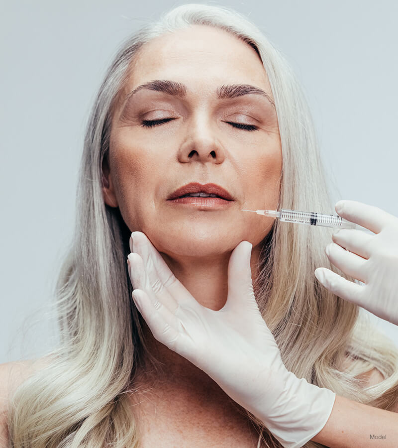 Mature woman getting lip injection